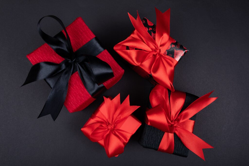 red ribbon on black textile